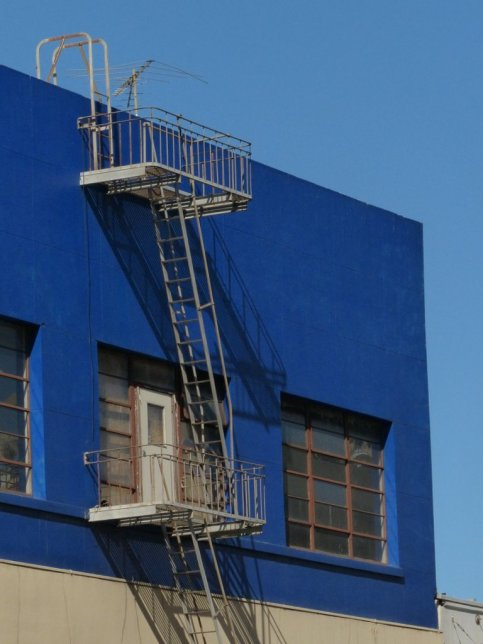 Fire escape and rooftop balcony.