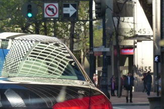 Signs and signs of life. Cars, lights, pedestrians—a city's rhythmic tango.